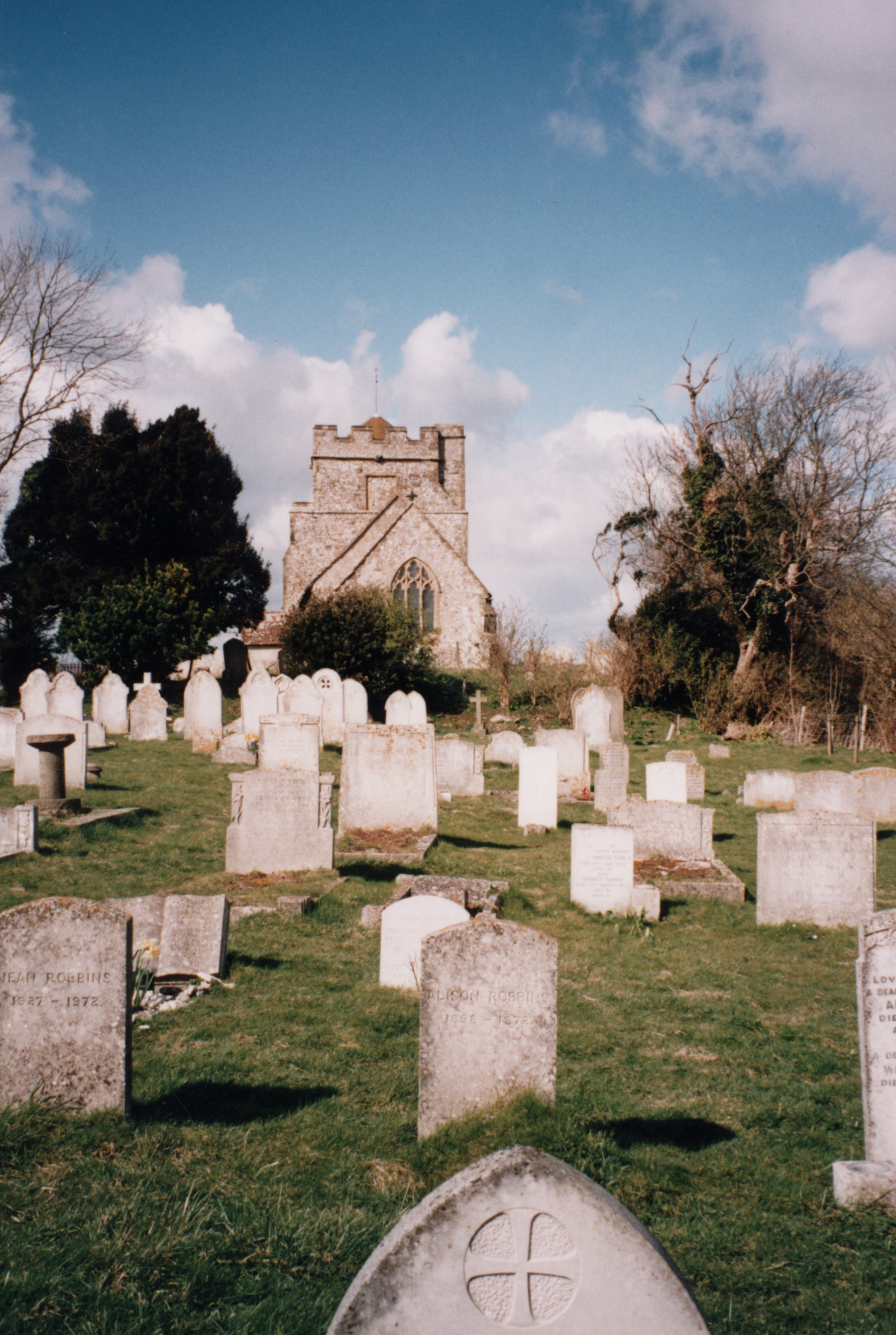 Graveyard looking west taken in 1995 before the Holm oaks grew up obscuring the view of the church from the Ringmer road